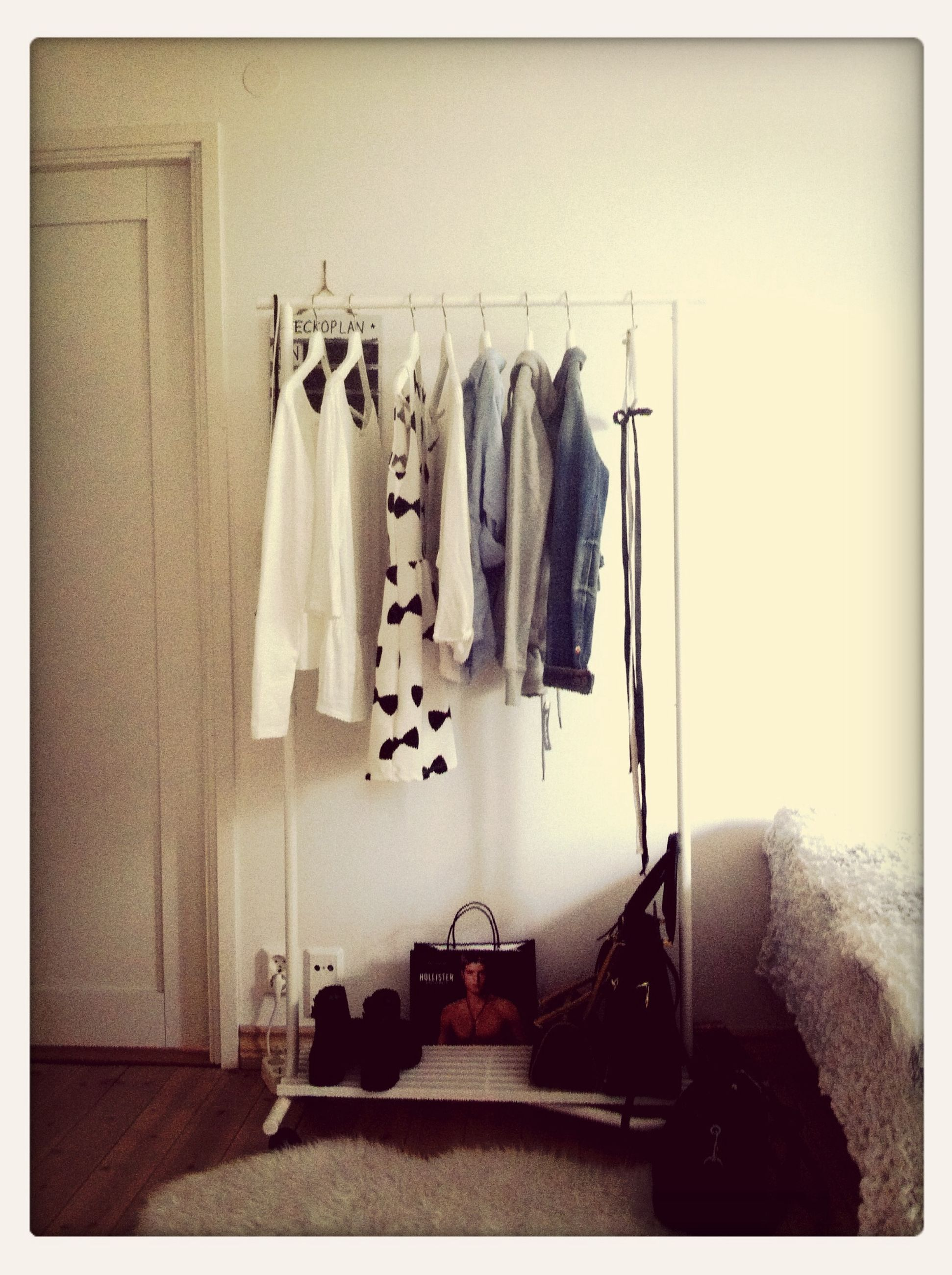 indoors, transfer print, auto post production filter, wall - building feature, still life, hanging, home interior, wall, table, shelf, in a row, no people, large group of objects, arrangement, variation, side by side, absence, copy space, day, order