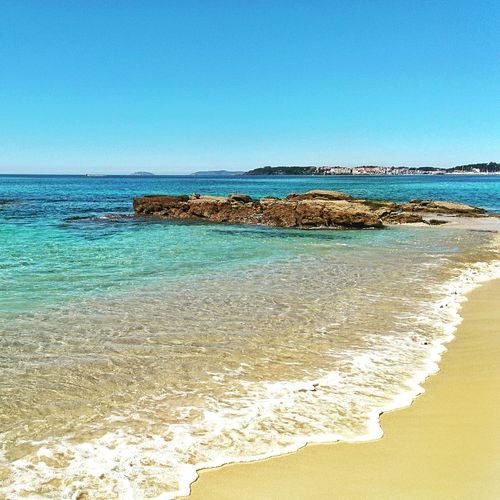 Áreas Beach Beach Waves Splashing Sand Stones Coastline Summer Sunshine Sea Galicia, Spain Clear Sky Water Outdoors