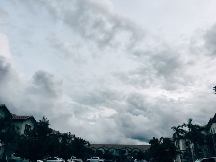 Cloud - Sky Sky Architecture Built Structure Low Angle View Building Exterior Tree House Weather No People Nature Day Outdoors Storm Cloud Beauty In Nature Scenics City