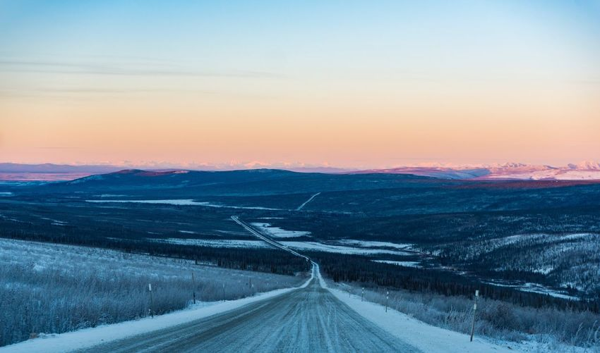 Road Beauty In Nature Nature Scenics Tranquil Scene Landscape Transportation Cold Temperature Sunset Tranquility Winter The Way Forward Snow No People Outdoors Mountain Remote Sky Day Rural Scene Alaska Arctic