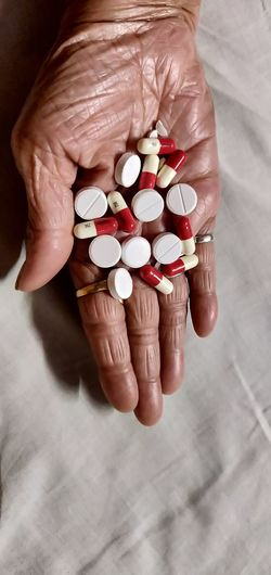 Close-up of person holding pills