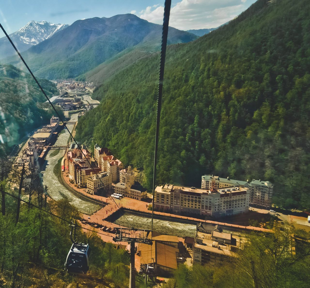 mountain, transportation, day, nature, outdoors, mode of transport, high angle view, beauty in nature, scenics, no people, landscape, cable, mountain range, tree, sky, overhead cable car, architecture, ski lift