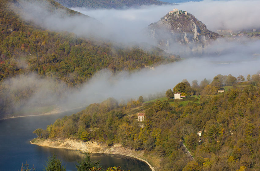 Beautiful view of turano lake with fog at sunrise morning Antuni Borgo Autumn Italia Landscape_Collection Travel Turano Turano Lake Wood Abandoned Antuni Beauty In Nature Enchanted  Europe Fog Foggy Foliage Ghost Town Hill Italy Lago Del Turano Landscape Mountain Rieti Scenics - Nature Village