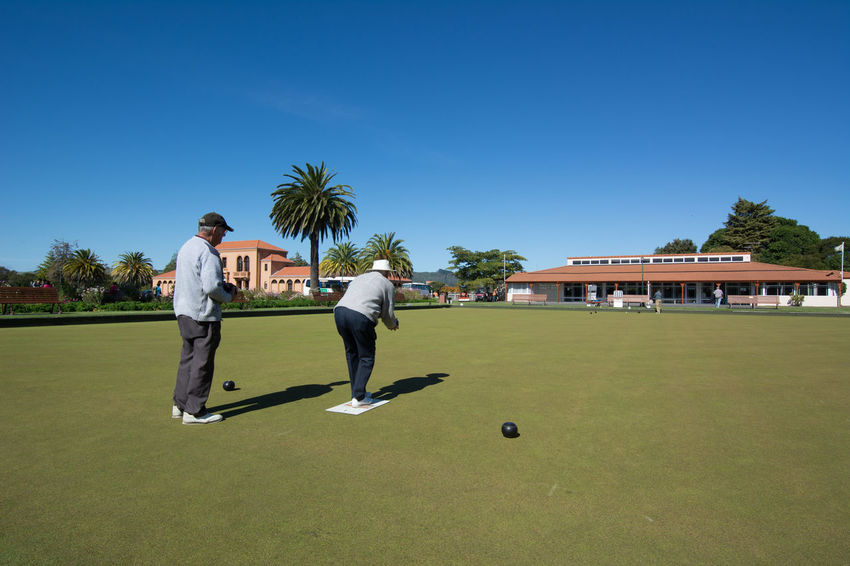 Two elderly men playing boccia in Rotorua, New Zealand. Boccia Clear Sky Game Green Color Lifestyles Outdoors Rotorua New Zealand Sky