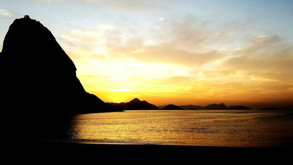 Sunset Beach Sea Water Sky Landscape Scenics Outdoors Travel Destinations No People Cloud - Sky Tranquility Horizon Over Water Sand Nature Beauty In Nature Blue Vacations Day Andersonmachadoart Artphotography Rio De Janeiro Praiavermelha Urca Beach Urca