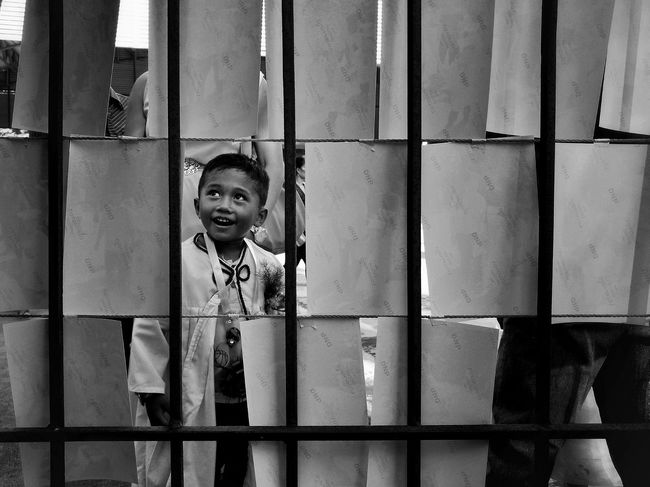 The Portraitist - 2017 EyeEm Awards The Street Photographer - 2017 EyeEm Awards The Photojournalist - 2017 EyeEm Awards One Person Boys Smiling Real People Happiness Day Childhood Child One Boy Only Streetphotography Eyeem Philippines Frame In Frame Graduation Monochrome Black And White This Week On Eyeem BYOPaper!
