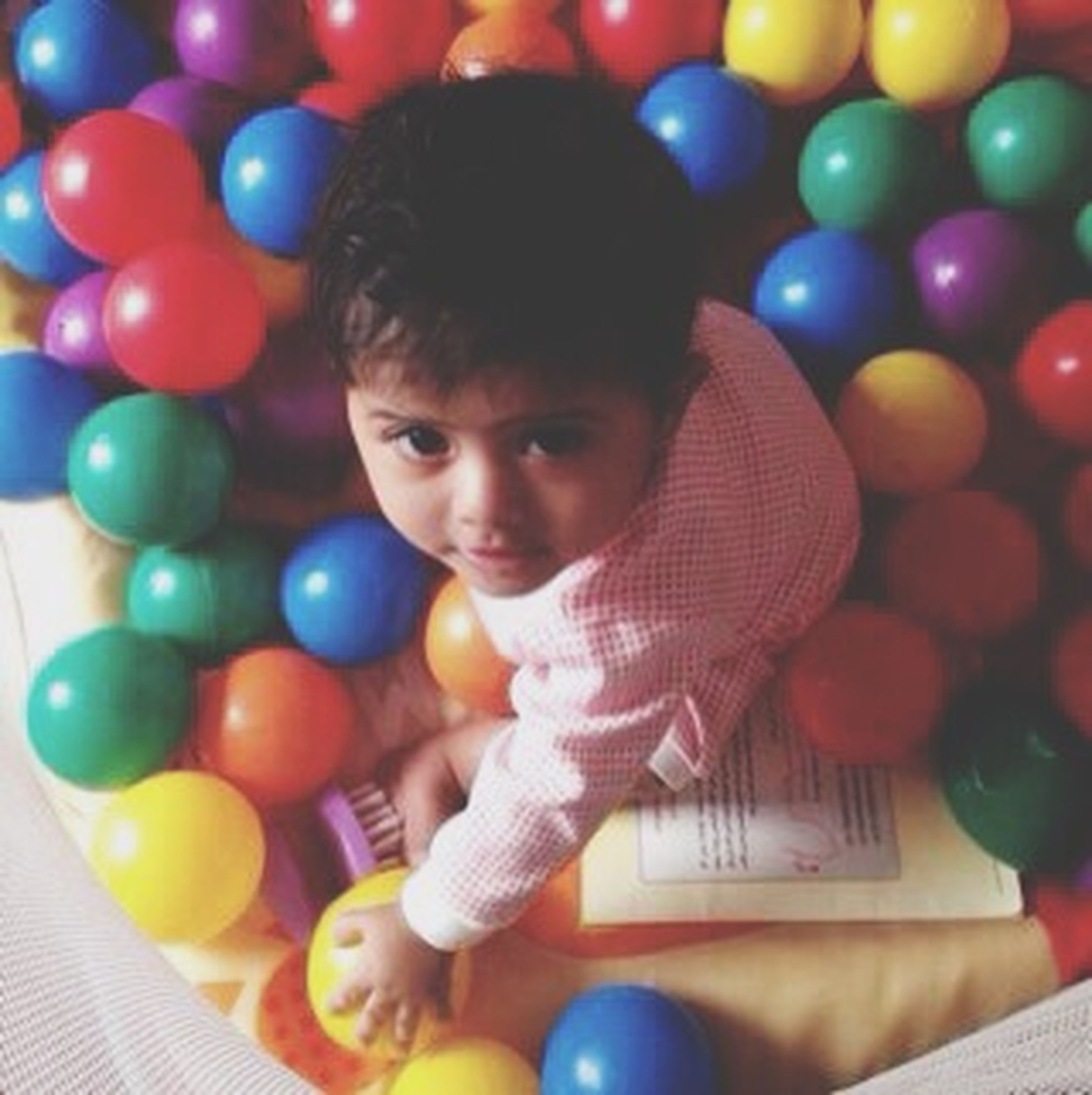 childhood, elementary age, innocence, indoors, cute, boys, toy, leisure activity, girls, playful, lifestyles, multi colored, playing, person, ball, fun, portrait, high angle view
