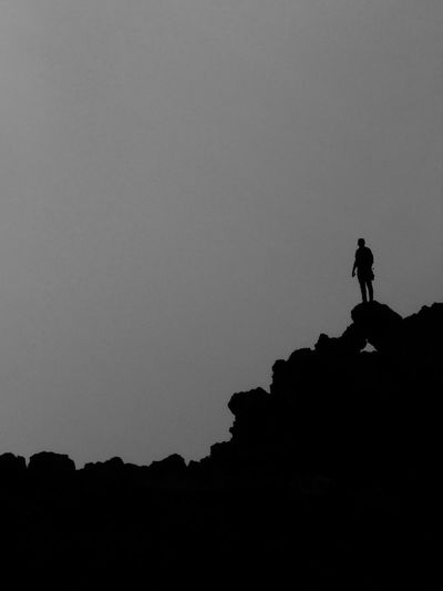 Silhouette Copy Space Silhouette Copy Space Clear Sky Mountain Tranquility Nature Tranquil Scene Cliff Scenics Mountain Peak Beauty In Nature Outdoors Sky Carefree Remote Solitude Non-urban Scene Nature No People Famous Place Popular Landscape Tourism