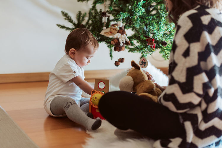 Cute boy with toy at home