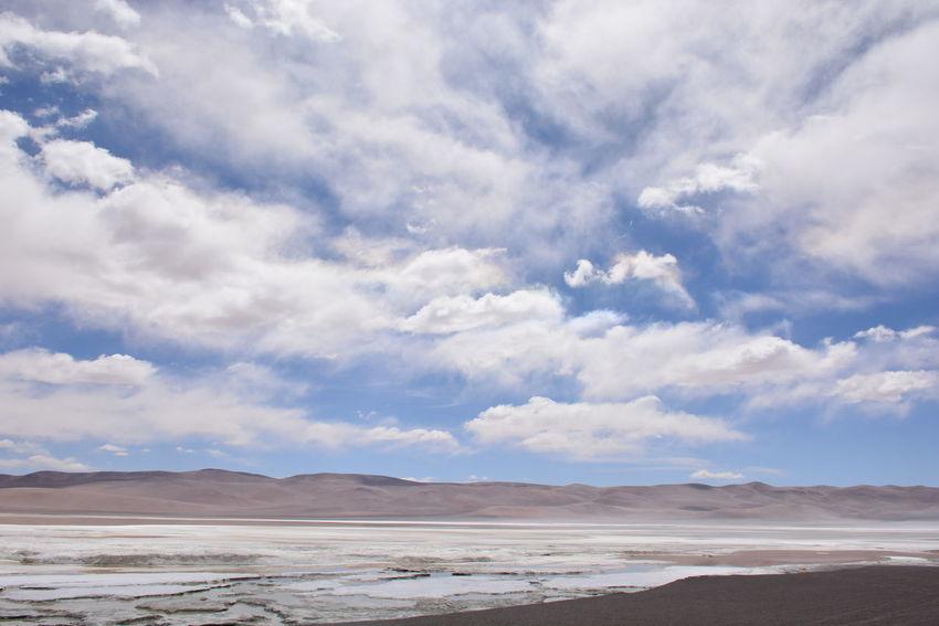 landscape of salt flats in Atacama desert, Chile Atacama Desert Holidays Nature Salt Flats Desert Landscape Mineral Mountain Range Mountains And Sky Salt Flat