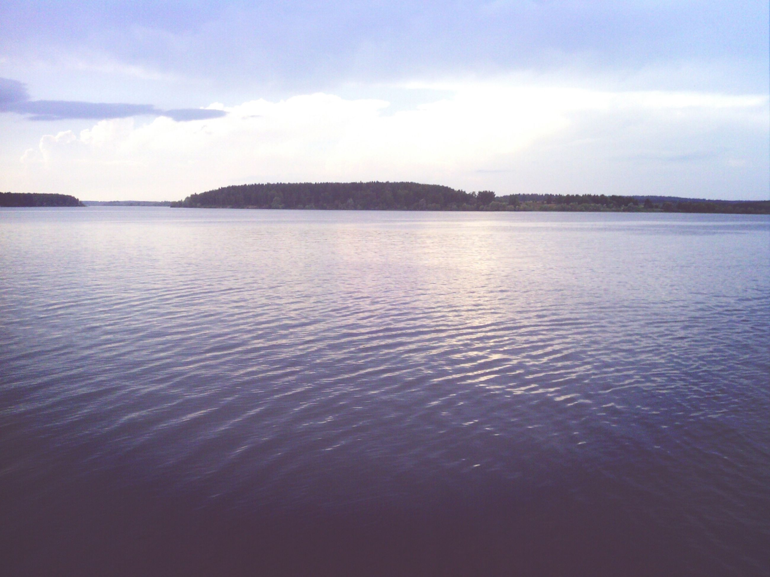 water, tranquil scene, sky, waterfront, scenics, tranquility, beauty in nature, rippled, cloud - sky, nature, lake, sea, cloud, idyllic, reflection, mountain, calm, outdoors, no people, cloudy