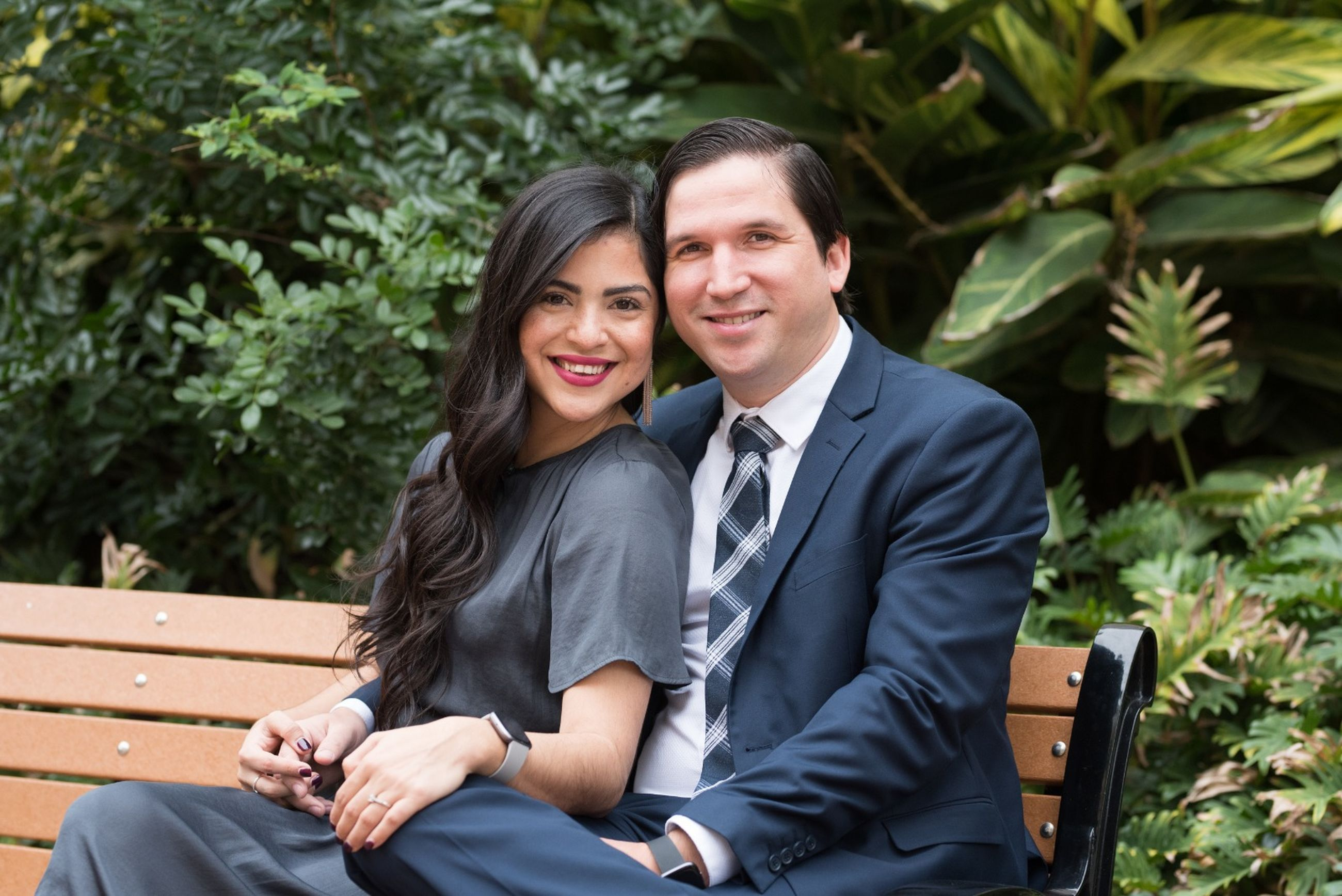 two people, sitting, young adult, men, adult, couple - relationship, love, young women, well-dressed, young men, women, smiling, front view, togetherness, looking at camera, three quarter length, portrait, suit, positive emotion, outdoors