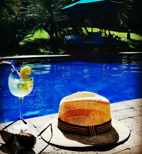 Close-up of beer on table by swimming pool