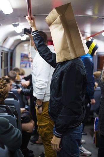 man with paper bag on his head rides the bus Bag On Head Hipster Bus Group Of People Transportation Mode Of Transportation Public Transportation Adult Men Passenger Travel People