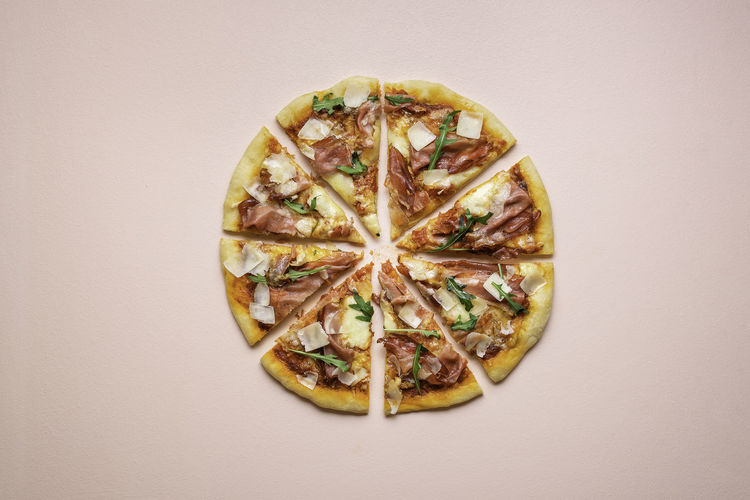 Directly above shot of pizza against white background