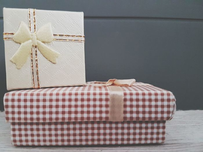 Close-up of wrapped gift boxes on table