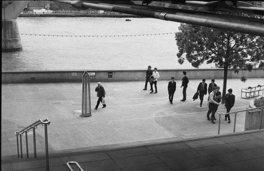 millennials? london on 35mm film june 2015 35mm Film Analogue Photography B&w Street Photography Bridge City City Life Everybodystreet Film Photography Filmisnotdead Ilford Lifestyles London Men Millennium Bridge Street Photography Streetphotography Travel Photography Uk Urban Urban Landscape Thames EyeEm LOST IN London