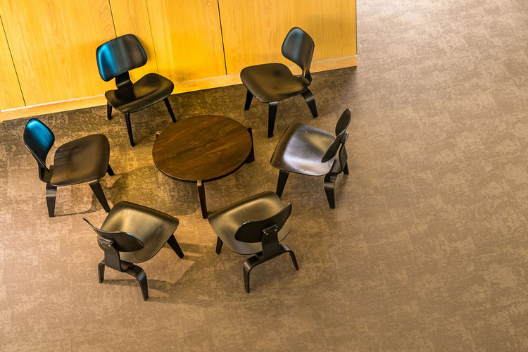 High angle view of empty chairs and table on floor