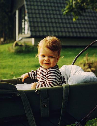 Portrait of cute boy in a stroller