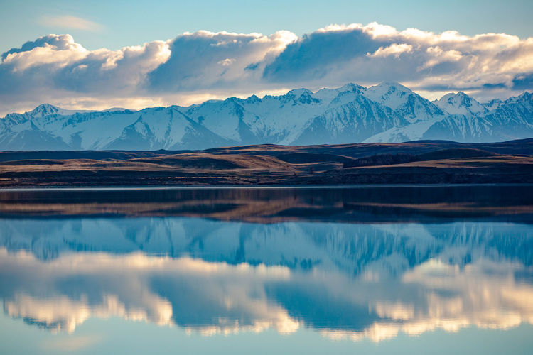 Beauty In Nature Cold Temperature Environment Lake Lake Tekapo Landscape Mountain Mountain Range New Zealand Outdoors Reflection Scenics - Nature Snow Snowcapped Mountain Tekapo Tranquil Scene Tranquility Water Winter