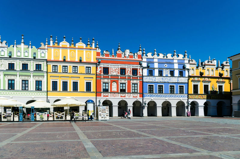 People Blue Window Tourist Palace Summer Sky Travel Destinations City Life Old House Outdoors Cultures Built Structure History Cityscape Tourism Travel Building Exterior Façade Town Square Town City Famous Place Urban Scene Street Europe Architecture My Best Photo