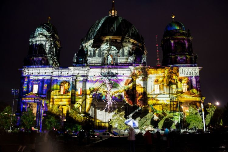 Exterior of berlin cathedral during festival of lights at night