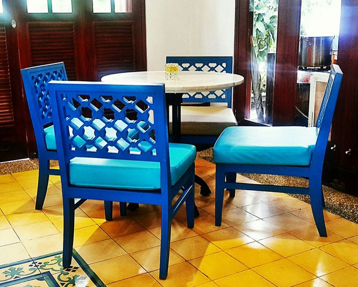 Eyeemmarket Chair Armchair No People Indoors  Table Domestic Room Day Interior Design Interior Style Cafe Cafés True Blue Sunlight ☀ Sunlight Reflection Flooring Floortraits Floor Tiles Floor Patterns Beautiful Decorations