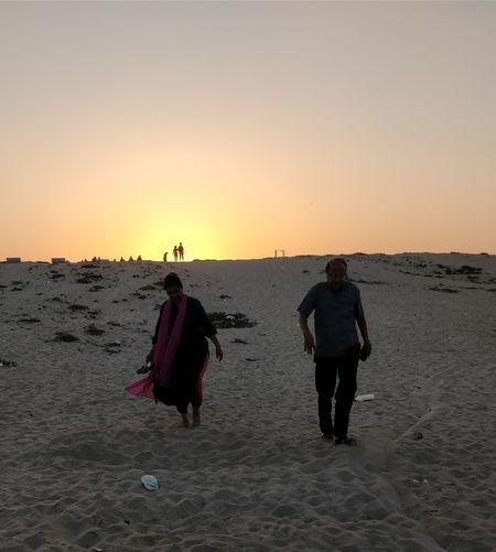 40+ years of bond still enjoying the sunset An Eye For Travel Sand Sunset Beach Walking Sea Full Length Heat - Temperature