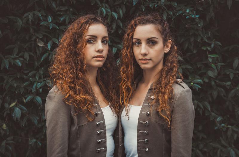 Portrait of siblings against plants