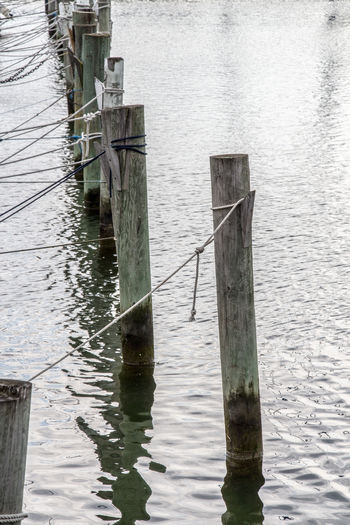 Architecture Building Exterior Built Structure Day Jetty Lake Nature Outdoors Pier Railing Reflection Rippled River Ropes Sea Tighten Tightenup Water Water Reflections Waterfront Wood Wood - Material Wooden Wooden Post