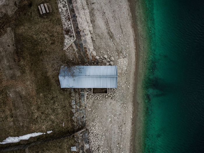 top down drone shot from a little boat-cabin at the walchensee in bavaria Water No People Day Architecture Built Structure Nature Outdoors Absence Wall - Building Feature Beach Sea Land Close-up Wet Cold Temperature Sand Abandoned Metal Turquoise Colored Dji Top Down View Walchensee Bayern Bavaria Germany Outside Nature Cabin Lake River Calm Lake Tranquility Tranquil Scene Hiking Wanderlust EyeEm Best Shots EyeEm Nature Lover EyeEm Selects Blue Discover Your City Earth DJI Mavic Pro DJI X Eyeem