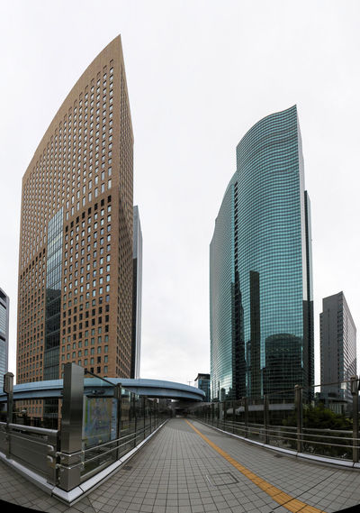 Modern buildings against sky in city