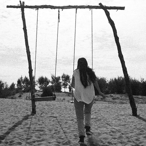 Past away Rear View Real People One Person Adults Only Childhood People Outdoors Leisure Activity Sky Day Tree Swing Adult beach Beach Blackandwhite