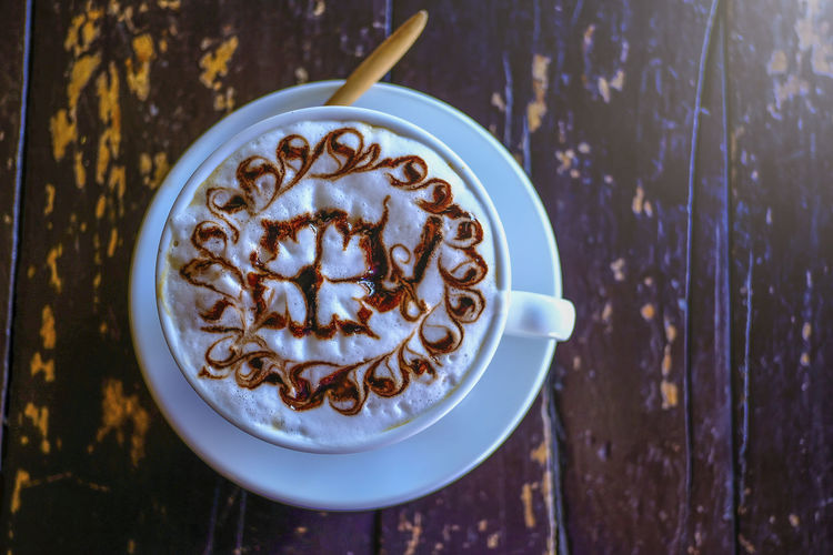 Directly above shot of cappuccino on table