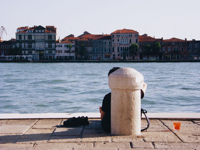 Resting in front of the Giudecca canal & island, dreaming in such a calm and inspiring urban environment Architecture Bollard Building Exterior Built Structure Canal City Clear Sky Day Dreaming Giudecca In Front Of Island Laguna Outdoors Residential District Resting Rippled Skyline Sunny Day Town Tranquil Scene Urban Venezia Venice, Italy Water Your Ticket To Europe
