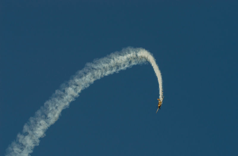 Aerobatics Airshow Blue Clear Sky Day Extreme Sports Flying Low Angle View Mid-air No People Outdoors Performance Sky Smoke - Physical Structure Stunt Transportation