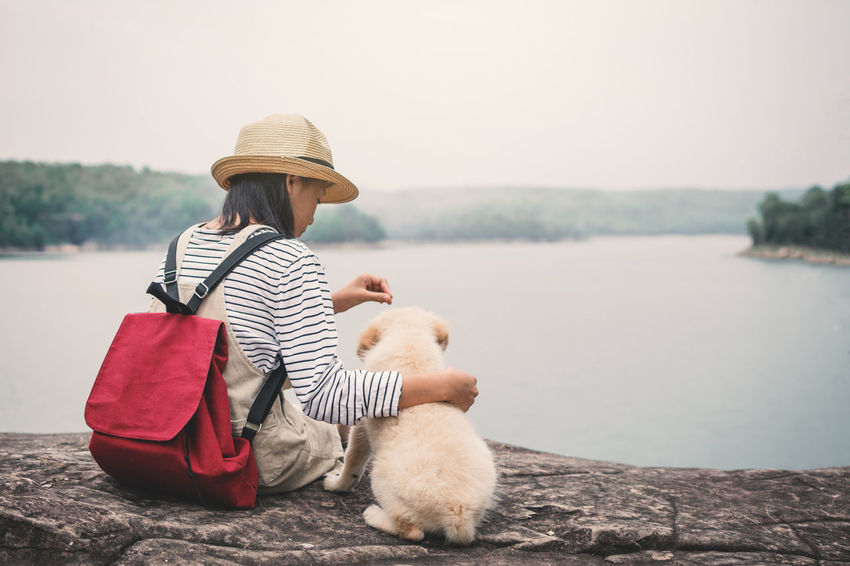 Happiness Nature Relaxing Travel Bag Cute Dog Girl Hat Little Mammal One Animal One Person Pets Playing Water