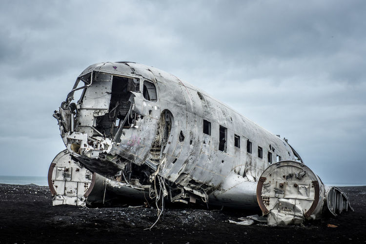 Plane Iceland Abandoned Accidents And Disasters Aerospace Industry Air Vehicle Airplane Beach Broken Cloud - Sky Crash Damaged Day Decline Demolished Destruction Deterioration Iceland_collection Mode Of Transportation Nature Navy No People Obsolete Outdoors Ruined Sky Transportation Travel EyeEmNewHere