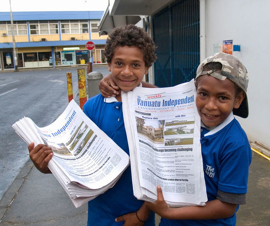 Newspaper Boys Port Vila,Vanuatu is a Pacific island nation located in the South Pacific Ocean. The archipelago, which is of volcanic origin, is some 1,750 kilometres (1,090 mi) east of northern Australia, 540 kilometres (340 mi) northeast of New Caledonia, east of New Guinea, southeast of the Solomon Islands, and west of Fiji. Vanuatu was first inhabited by Melanesian people. The first Europeans to visit the islands were a Spanish expedition led by Portuguese navigator Fernandes de Queirós, who arrived on the largest island in 1606. As the Portuguese and Spanish monarchies had been unified under the king of Spain in 1580 (following the vacancy of the Portuguese throne, which lasted for sixty years, until 1640, when the Portuguese monarchy was restored), Queirós claimed the archipelago for Spain, as part of the colonial Spanish East Indies, and named it La Austrialia del Espíritu Santo. In the 1880s, France and the United Kingdom claimed parts of the archipelago, and in 1906 they agreed on a framework for jointly managing the archipelago as the New Hebrides through a British–French Condominium. An independence movement arose in the 1970s, and the Republic of Vanuatu was founded in 1980. Architecture British–French Condominium Day Looking At Camera New Hebrides Outdoors Pacific Ocean Pentecost Island People Port Vila Vanuatu Portrait Smiling South Pacific Ocean Tam Tam Tanna Vanuatu Togetherness Tourism Tourist Attraction  Travel Travel Destinations Two People Vanuatu Vivid International