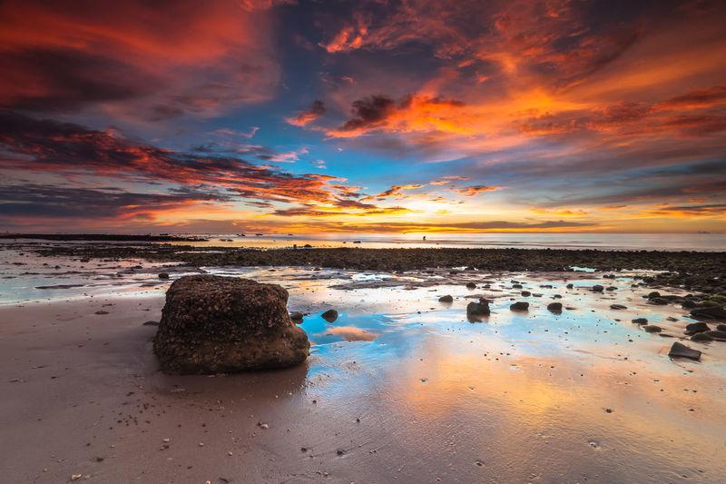 Scenic view of sunset at kuala penyu beach, west malaysia