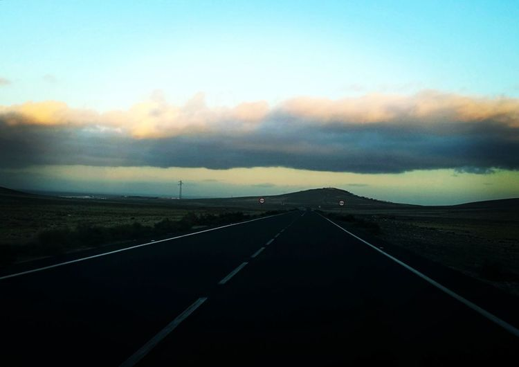 Road Sunset Street Sky Landscape Cloud - Sky Travel Empty Road Mountain Road Two Lane Highway Winding Road Car Point Of View Windshield Tire Track Asphalt Highway Diminishing Perspective Country Road Dividing Line