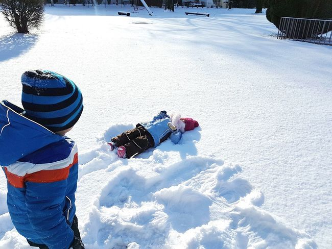 Winter Snow Cold Temperature Sunlight Adventure Vacations Two People Warm Clothing Togetherness Outdoors Children Playing