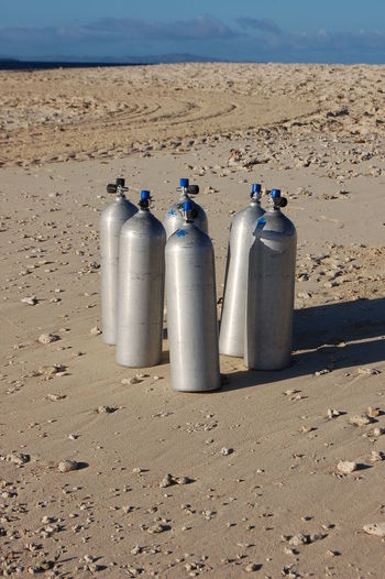 Scuba Tanks on the beach. Beachcomber Island. Fiji Land Sand Beach Nature Sunlight No People Day Water Sea Environment Outdoors Metal High Angle View Summer Silver Colored Scuba Diving Scuba Tanks Fiji Beachcomber Island Tropical Climate Close-up