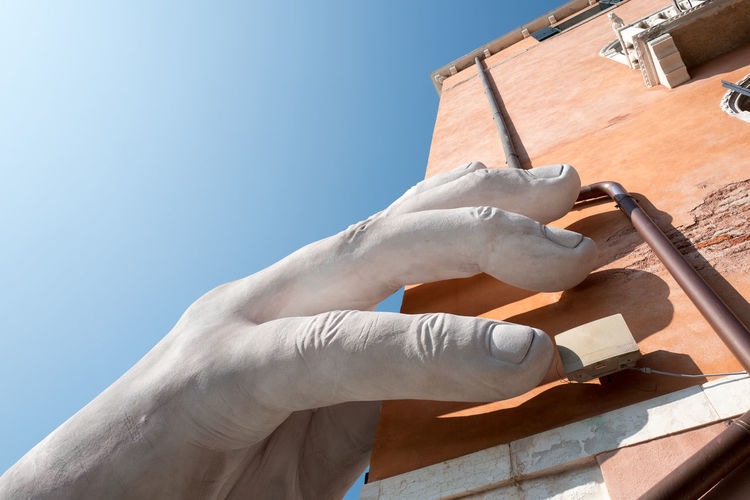 VENICE, ITALY - OCTOBER, 2017: Big hands sculpture rise from the water in Venice to highlight climate change Canal Grande Venezia Venice, Italy Architecture Art Arts Culture And Entertainment Biennale Built Structure Clear Sky Climate Change Close-up Day Environment Environmental Conservation Human Body Part Human Hand Majestic One Person Outdoors Sculpture Sky Social Issues Tourist Destination