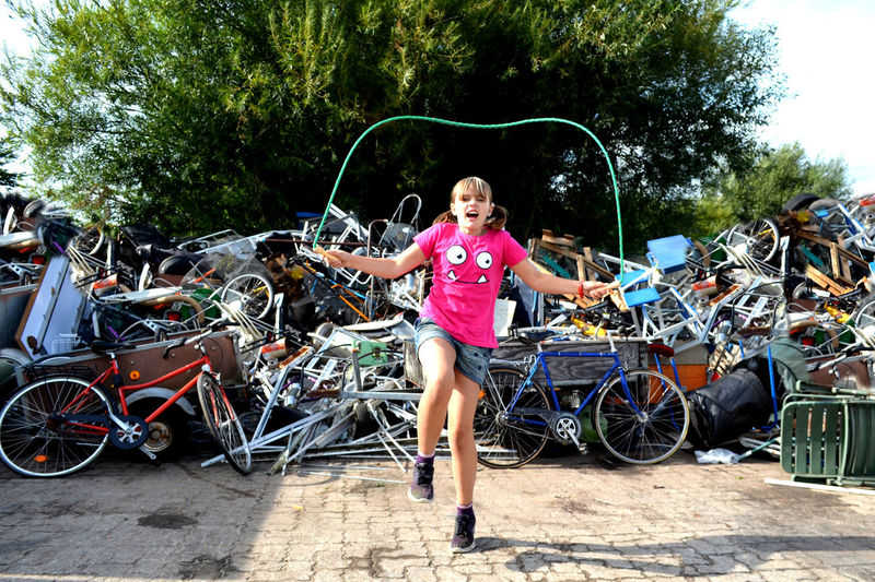 Bicycle Casual Clothing Child Childhood Day Dump Front View Full Length Ghetto Girl Innocence Leisure Activity Looking At Camera Odd Place One Person Outdoors Playing Portrait Real People Scrap Shorts Smiling Tree Urban Young Girl #urbanana: The Urban Playground EyeEmNewHere