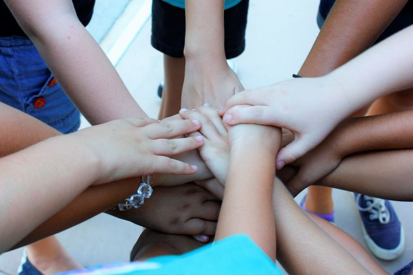 Girl Scouts coming together Child Childhood Friendship Girls Human Body Part Human Hand Leisure Activity Medium Group Of People Outdoors Real People Teamwork Togetherness Unity