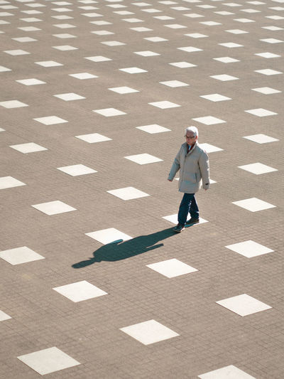 Full Length One Person Sunlight Shadow Day Motion Men Walking Adult on the move High Angle View Nature Businessman Males  Business Person Business Standing Front View Outdoors The Street Photographer - 2019 EyeEm Awards My Best Photo