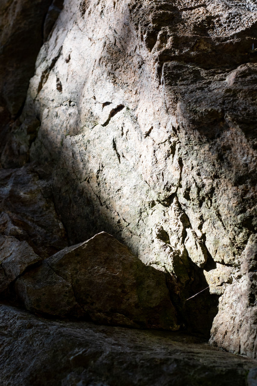 rock, rock - object, solid, rock formation, no people, textured, geology, nature, rough, day, low angle view, outdoors, cave, close-up, physical geography, eroded, tranquility, backgrounds, beauty in nature