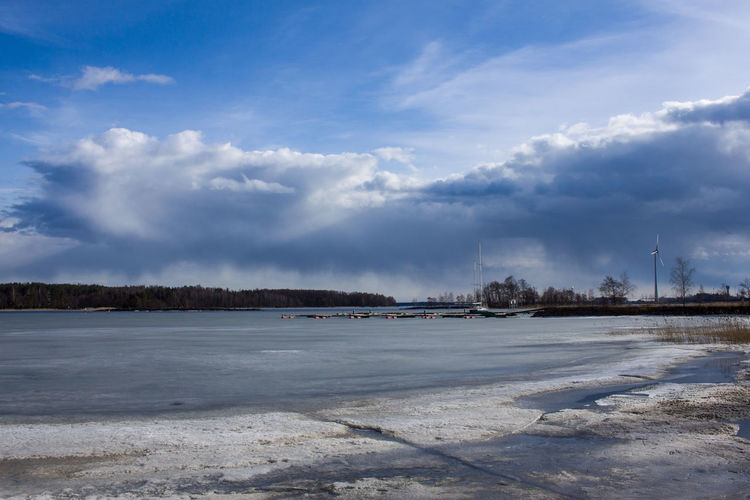 Beauty In Nature Cloud - Sky Cold Temperature Day Frozen Ice Lake Landscape Nature No People Outdoors Sky Snow Tranquility Weather Winter