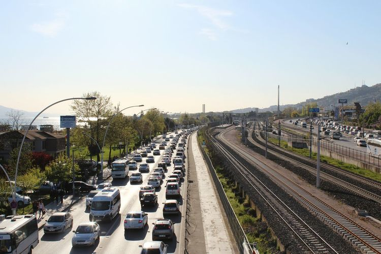 Railroad Tracks And Traffic In City